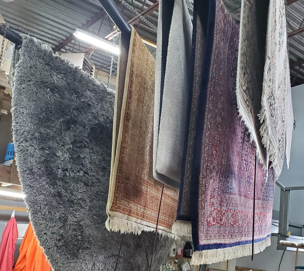 Cleaning carpets in the workshop